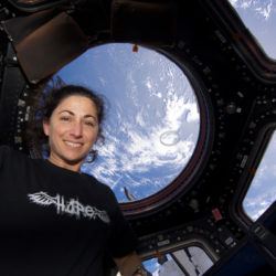 nicole stott astronaut at international space station looking at earth